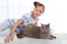 Beautiful Little Girl With Cat In Room