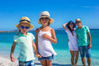 Happy family of four during summer beach vacation