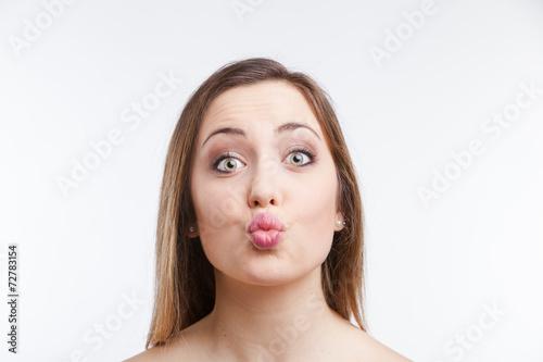 Fotografia, Obraz  Kissing Young Woman Portrait