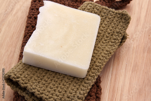 Fotografie, Obraz  White Handmade Soap with Handmade Cotton Washcloths