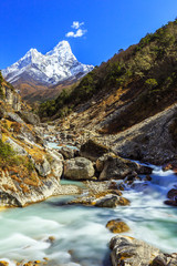 Fototapeta Góry Snow covered mountains and rocky peaks in Himalaya
