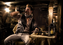 Pirate Drinking From Bottle In Ship Quarters