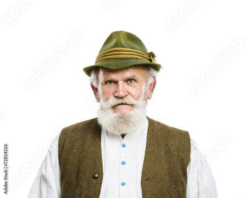 Stampa su Tela Old bavarian man in hat on white background