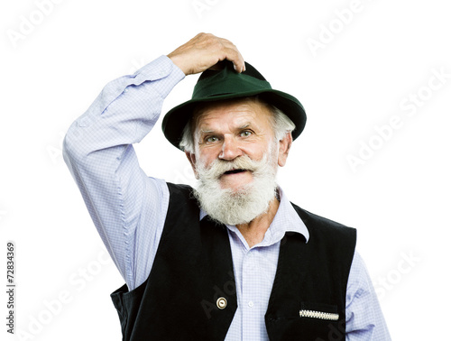 Fotografie, Obraz  Old bavarian man in hat on white background