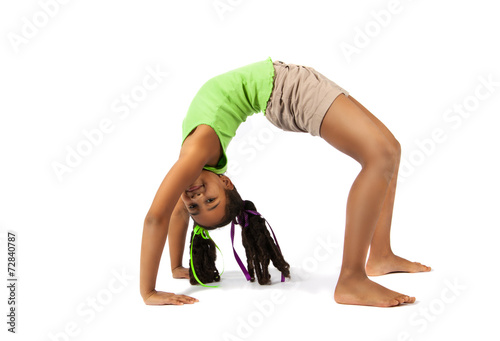 Young baby artistic gymnast doing bridge, isolated