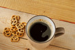 A Cup of hot coffee and biscuits lying on the table