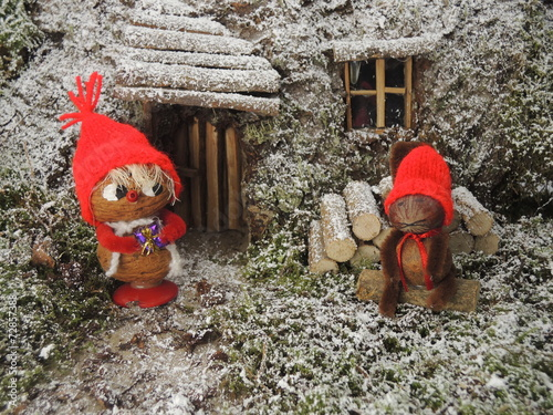 Fotografie, Obraz  Christmas card - gnome in front of  cosy home in the forest