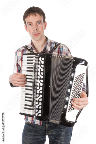 Valokuva  Man playing an accordion isolated over white