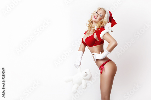Foto  beautiful and sexy woman dresses as a sexy santa claus