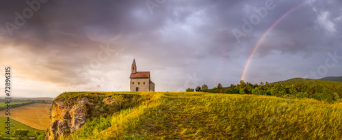 Tuinposter Lavendel Old Roman Church at Sunset in Drazovce, Slovakia
