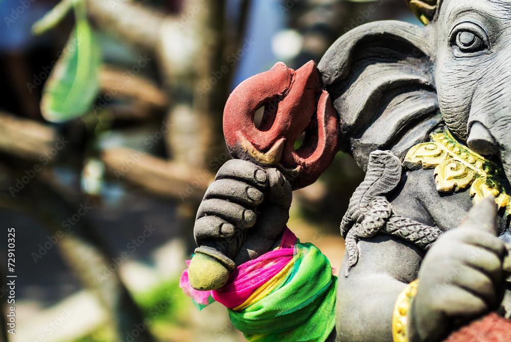 Photo  An Ganesha made of stone in bali .