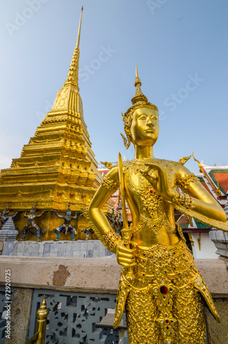 Golden Kinnari statue at the temple of the Emerald Buddha Poster