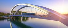 Tramway Crossing Bridge At Sun...