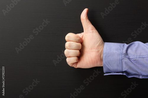 Thumbs Up sign in front of a blackboard Canvas Print