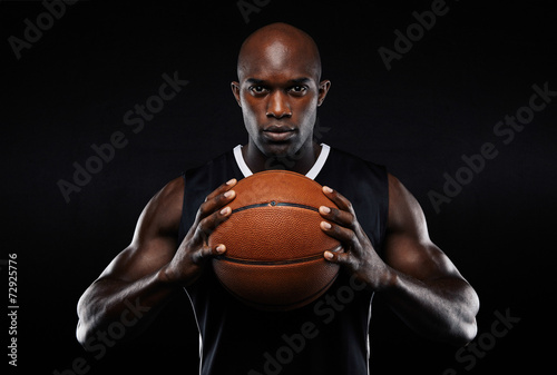 Afro american male basketball player with a ball