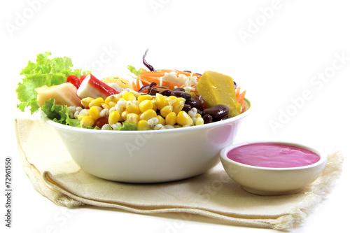 Fresh vegetable salad and salad cream on cotton cloth