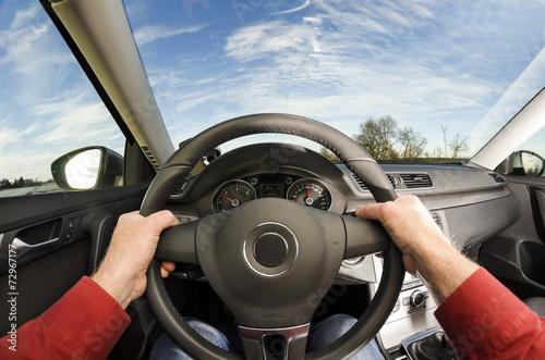 Driver's hands on steering wheel Fototapet