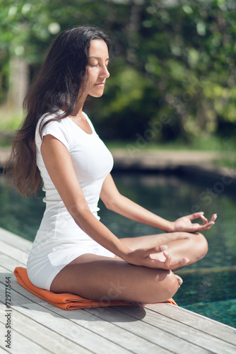 Slender Asian Indian Woman Doing Yoga At Poolside Buy This Stock Photo And Explore Similar Images At Adobe Stock Adobe Stock