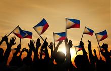 Group Of People Waving Filipin...