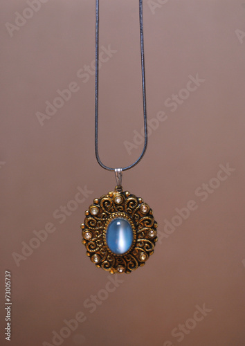 Fotografia, Obraz  necklace with moonstone isolated in beige background