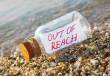 Bottle With A Message Out Of Reach On Beach.