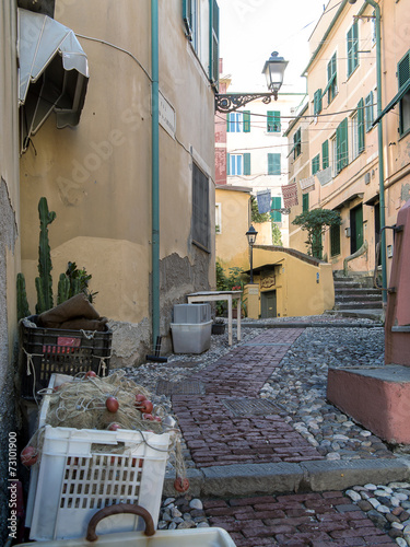 Photo sur Toile Drawn Street cafe Narrow cobbled street and fishing nets, Boccadasse