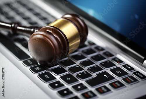 Justice gavel and laptop computer keyboard Canvas Print