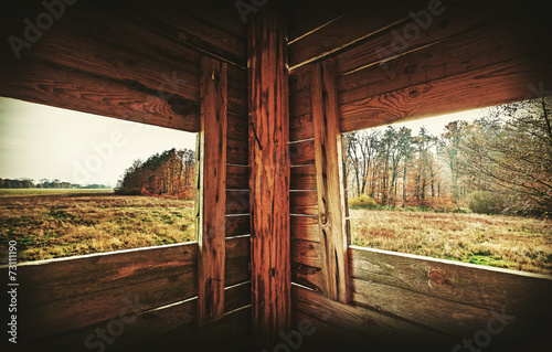 Poster Chasse Retro filtered interior of hunting tower in autumn season.
