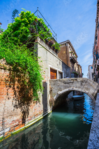 City on the water Narrow canal among old colorful brick houses in Venice