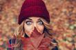 Leinwandbild Motiv beautiful blonde with leaf in front of face