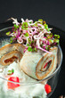 pickled fish rolls filled with paprika, egg salad and radish spr