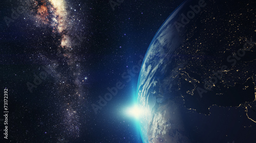 Fotobehang Heelal blue sunrise, view of earth from space with milky way galaxy