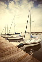 Retro Filtered Picture Of Yachts At Wooden Lake Bridge, Stepnica, Poland.