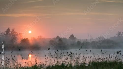 Purple haze sunrise over a lake Canvas Print