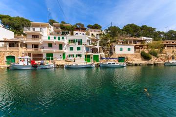Fototapeta na wymiar Boats anchored in port of fishing village Cala Figuera, Majorca