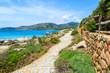 Walking path on coast of Sardinia island, Italy