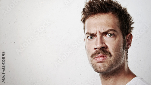 Valokuva  Portrait of an angry man with mustache