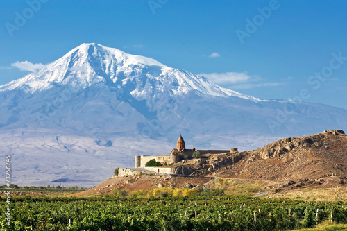 Tuinposter Blauwe jeans Landscape with an ancient monastery