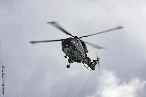 Tuinposter Helicopter Naval helicopter on training mission