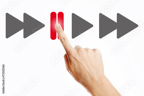 Male hand pressing pause button on the virtual screen Wallpaper Mural