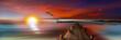 canvas print picture - Sonnenuntergang am Bootssteg mit Leuchtturm und Möwen