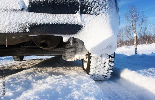 In de dag Milan Closeup of car tires in winter morning