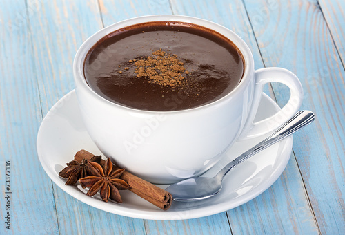 Foto op Canvas Chocolade Hot chocolate on wooden table