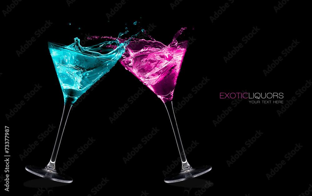 Fototapety, obrazy: Exotic Liquors. Stemmed cocktail glasses making a toast splashin