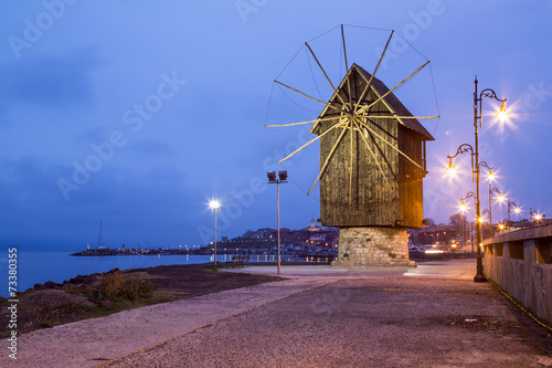 Poster Mills Wooden windmill in Nessebar at night
