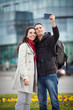 Young couple taking selfportrait on the street