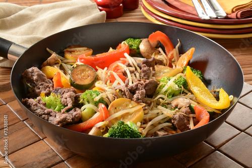 Photo  Stir fry in a wok
