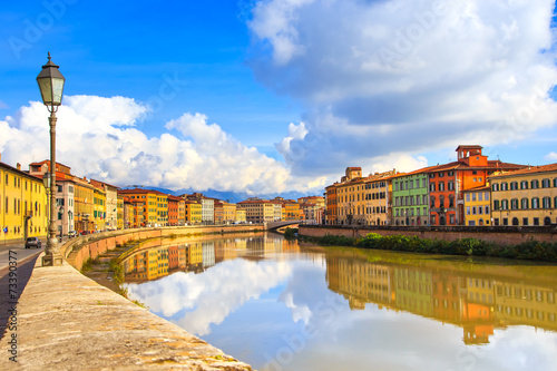 Fotografia, Obraz Pisa, Arno river, lamp and buildings reflection. Lungarno view.