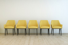Row Of Empty Chairs Against A Wall