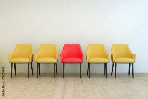 Fotografie, Obraz  Yellow chairs aligned with a red one in the middle